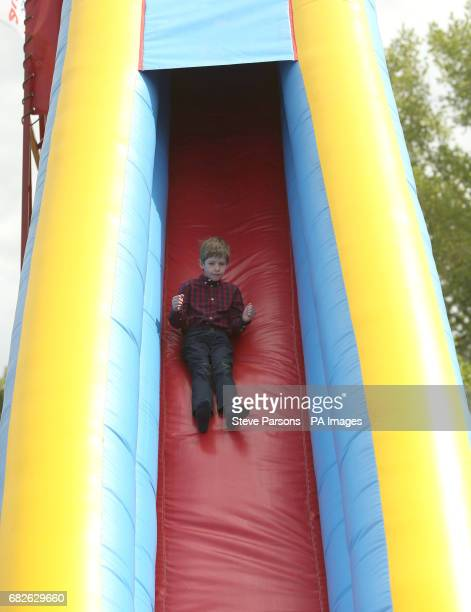 James Viscount Severn son of the Earl and Countess of Wessex goes on a slide during the Royal Windsor Horse Show which is held in the grounds of...