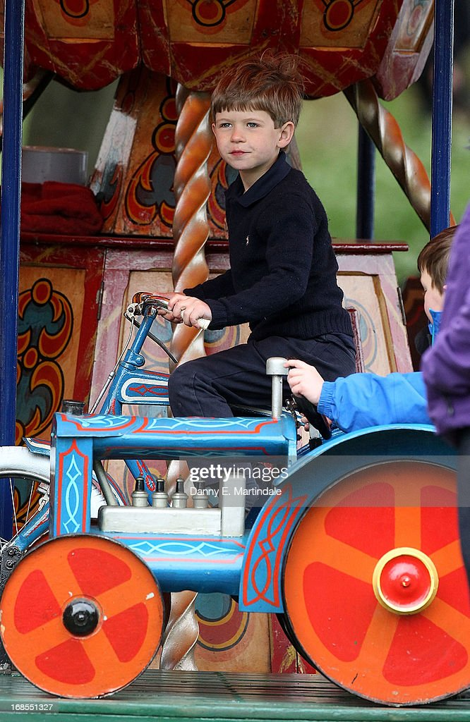 James, Viscount Severn the second child and only son of Prince Edward, Earl of Wessex, and Sophie, Countess of Wessex is seen playing on the fun fair carousel on day 4 of the Royal Windsor Horse Show on May 11, 2013 in Windsor, England.