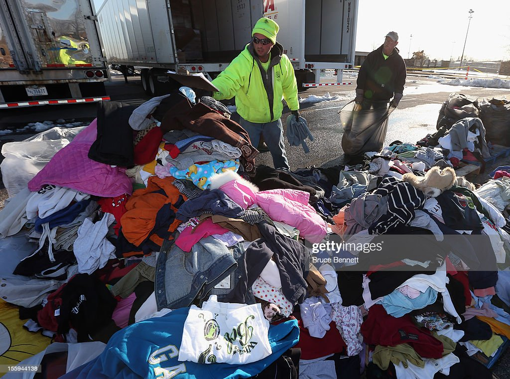 James Vouloukos and William Ferris sort through donated clothes at a site maintained by the Town of Hempstead in cooperation with FEMA at Oceanside Park during in the aftermath of Superstorm Sandy on November 9, 2012 in Oceanside, New York. New York Gov. Andrew M. Cuomo has said that the economic loss and damage to homes and businesses caused by Sandy could total $33 billion in New York, according to published reports.