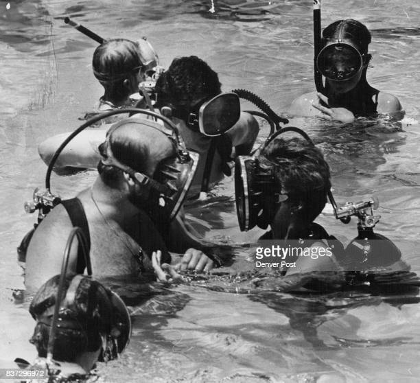 James W Smith Left And Karen Kidneigh Touch Face Masks After Their Underwater Marriage The masktouching kiss was a joke a moment later they took off...