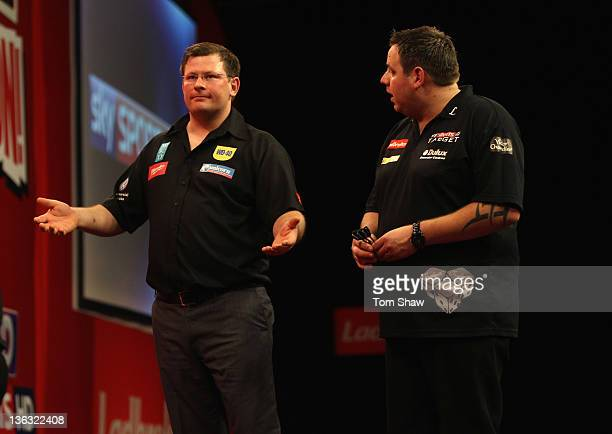 James Wade of England and Adrian Lewis of England complain about the conditions of play during the World Darts Championships Semi Final Match at...