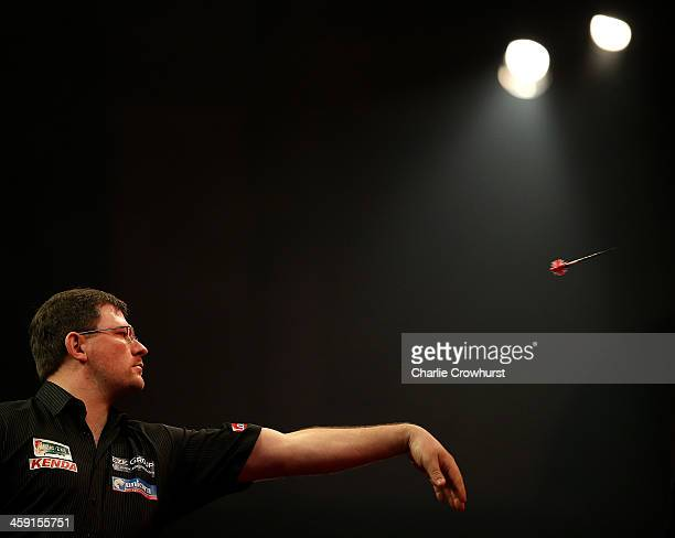 James Wade of England in action during his second round match against Andy Smith of England during the Ladbrokescom World Darts Championship on Day...