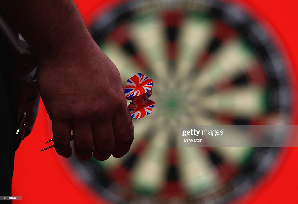 James Wade of England prepares to throw a dart during his Quarter Final match against Paul Nicholson of Australia during the 2009 Ladbrokescom PDC...