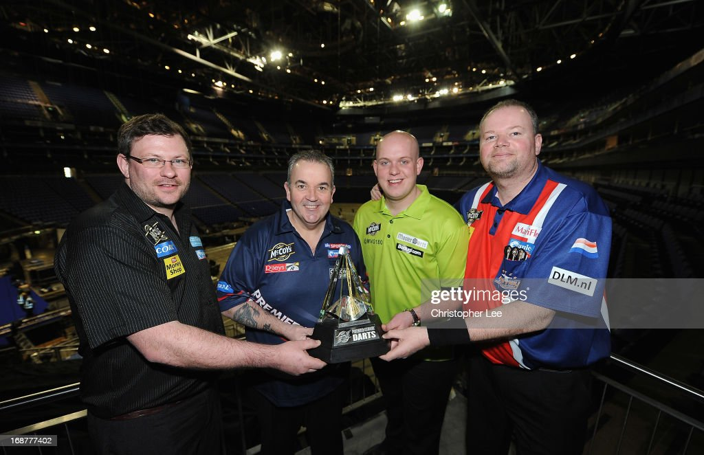 James Wade, Phil Taylor, <a gi-track='captionPersonalityLinkClicked' href=/galleries/search?phrase=Michael+van+Gerwen&family=editorial&specificpeople=4754172 ng-click='$event.stopPropagation()'>Michael van Gerwen</a> and Raymond van Berneveld pose with the McCoys Premier League Trophy during the McCoy's Premier League Darts Play-Offs Media Launch at O2 Arena on May 15, 2013 in London, England.