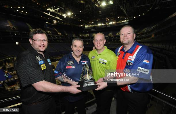 James Wade Phil Taylor Michael van Gerwen and Raymond van Berneveld pose with the McCoys Premier League Trophy during the McCoy's Premier League...