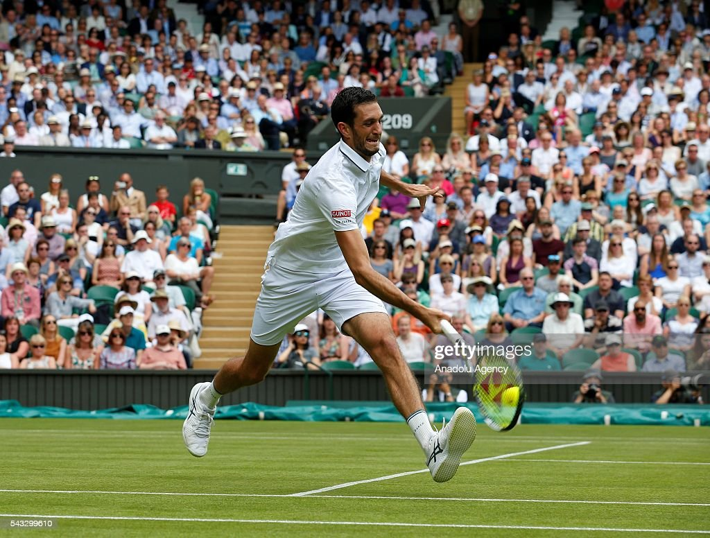 James Ward of England in action against Novak Djokovic of Serbia in the mens' singles on day one of the 2016 Wimbledon Championships at the All England Lawn Tennis and Croquet Club in London, United Kingdom on June 27, 2016.