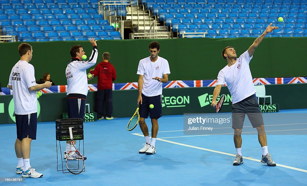 James Ward of Great Britain and Daniel Evans practice their serves during previews for the Davis Cup match between Great Britain and Russia at the Ricoh Arena on April 4, 2013 in Coventry, England.