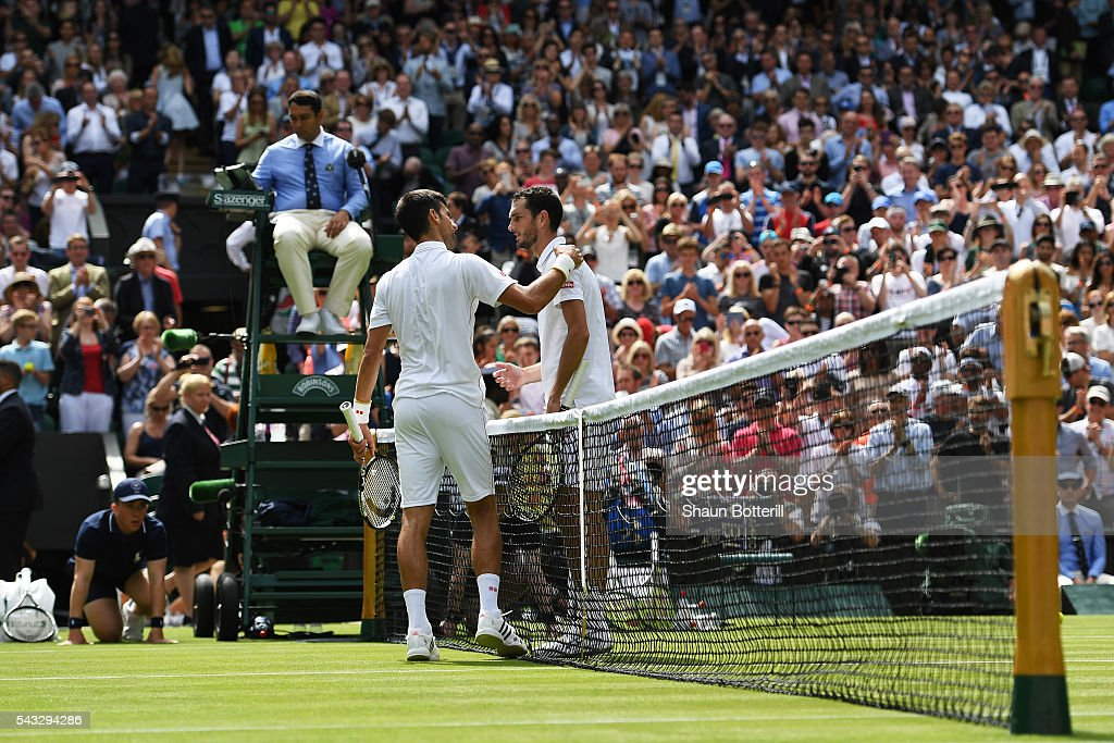 <a gi-track='captionPersonalityLinkClicked' href=/galleries/search?phrase=James+Ward+-+Tennis+Player&family=editorial&specificpeople=7863903 ng-click='$event.stopPropagation()'>James Ward</a> of Great Britain congratulates <a gi-track='captionPersonalityLinkClicked' href=/galleries/search?phrase=Novak+Djokovic&family=editorial&specificpeople=588315 ng-click='$event.stopPropagation()'>Novak Djokovic</a> of Serbia following the Men's Singles first round match on day one of the Wimbledon Lawn Tennis Championships at the All England Lawn Tennis and Croquet Club on June 27th, 2016 in London, England.