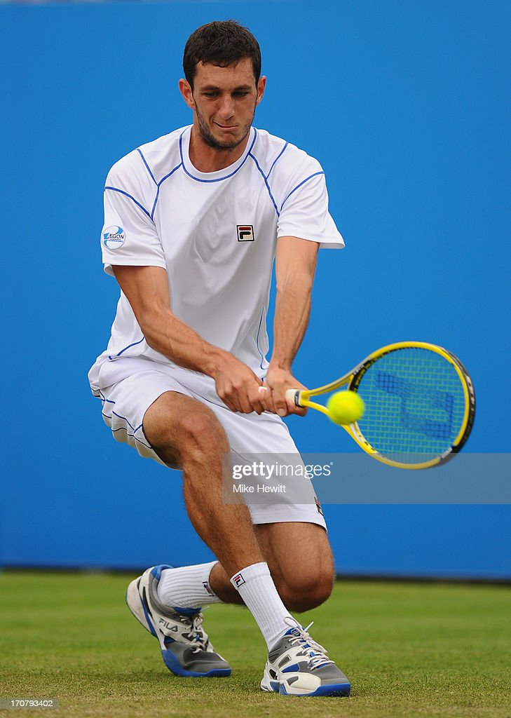 James Ward of Great Britain in action against Bernard Tomic of Australia during Day Four of the AEGON Internationa at Devonshire Park on June 18, 2013 in Eastbourne, England.