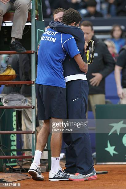 James Ward of Great Britain is congratulated by his captain Leon Smith after his five set victory against Sam Querrey of the United States during day...