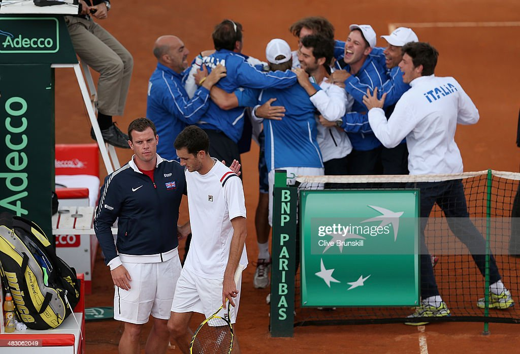 James Ward of Great Britain is consoled by his team captain Leon Smith after losing the fifth and decisive rubber to Andreas Seppi of Italy during day three of the Davis Cup World Group Quarter Final match between Italy and Great Britain at Tennis Club Napoli on April 6, 2014 in Naples, Italy.