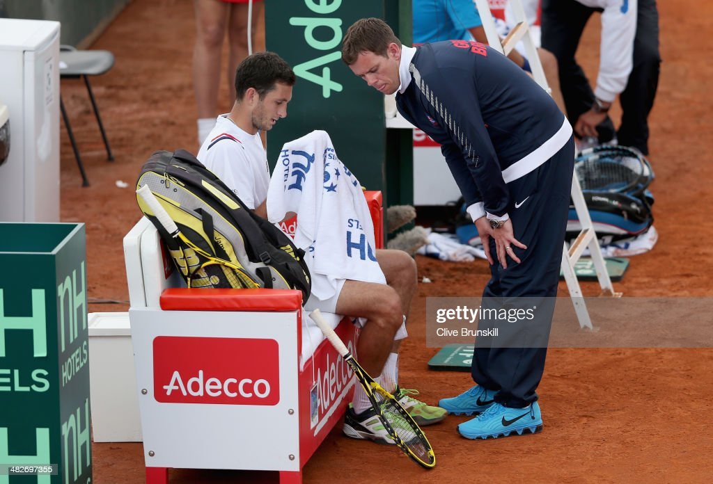 James Ward of Great Britain listens to advice from his team captain Leon Smith during his match against Fabio Fognini of Italy during day one of the Davis Cup World Group Quarter Final match between Italy and Great Britain at Tennis Club Napoli on April 4, 2014 in Naples, Italy.