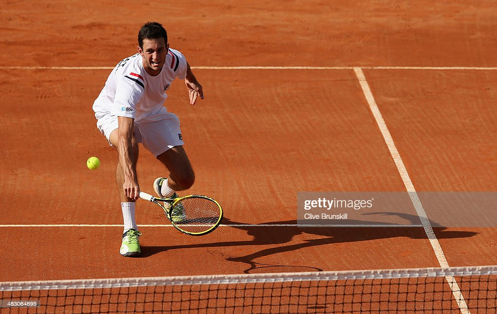 James Ward of Great Britain plays a backhand volley during the fifth and decisive rubber against Andreas Seppi of Italy during day three of the Davis Cup World Group Quarter Final match between Italy and Great Britain at Tennis Club Napoli on April 6, 2014 in Naples, Italy.