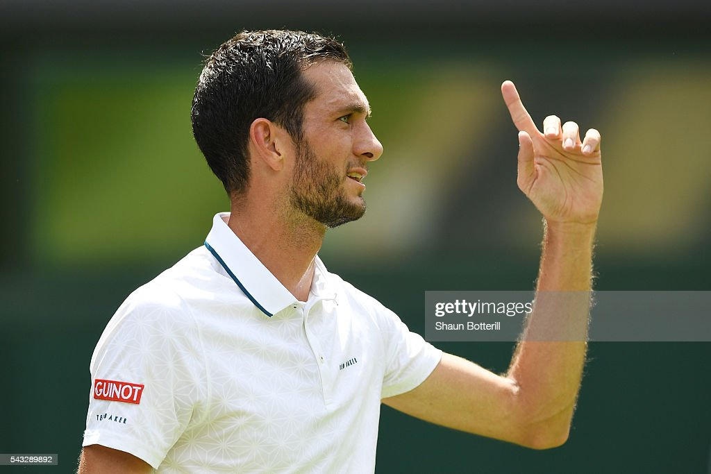 <a gi-track='captionPersonalityLinkClicked' href=/galleries/search?phrase=James+Ward+-+Tennis+Player&family=editorial&specificpeople=7863903 ng-click='$event.stopPropagation()'>James Ward</a> of Great Britain reacts during the Men's Singles first round against Novak Djokovic of Serbia on day one of the Wimbledon Lawn Tennis Championships at the All England Lawn Tennis and Croquet Club on June 27th, 2016 in London, England.