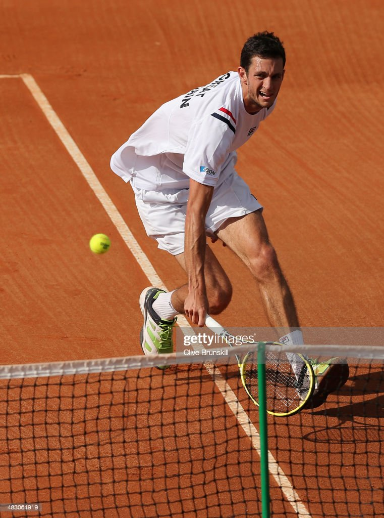 James Ward of Great Britain runs to play a backhand volley during the fifth and decisive rubber against Andreas Seppi of Italy during day three of the Davis Cup World Group Quarter Final match between Italy and Great Britain at Tennis Club Napoli on April 6, 2014 in Naples, Italy.