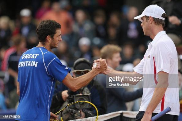 James Ward of Great Britain shakes hands at the net after his five set victory against Sam Querrey of the United States during day one of the Davis...