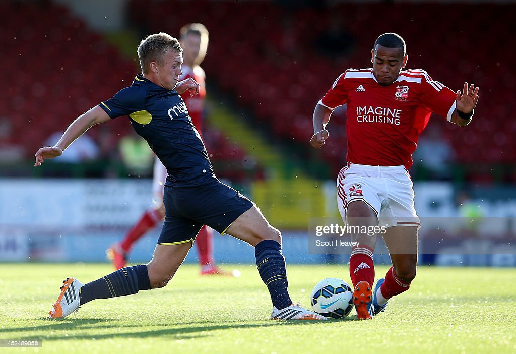 James Ward Prowse of Southampton in action with Louis Thompson of Swindon during the Pre Season Friendly between Swindon Town and Southampton on July...