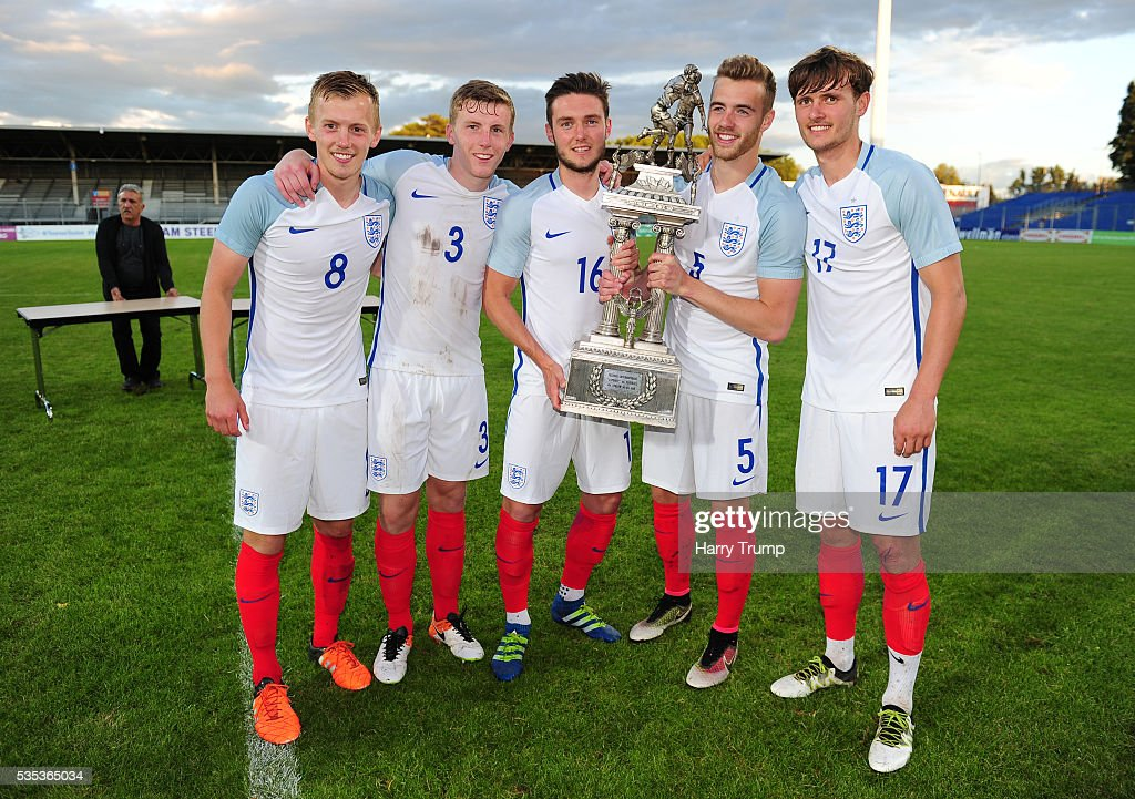 James Ward-Prowse, Matthew Targett, Matthew Grimes, Calum Chambers and John Swift of England pose with the trophy during the Final of the Toulon Tournament between England and France at Parc Des Sports on May 29, 2016 in Avignon, France.