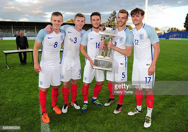 James WardProwse Matthew Targett Matthew Grimes Calum Chambers and John Swift of England pose with the trophy during the Final of the Toulon...