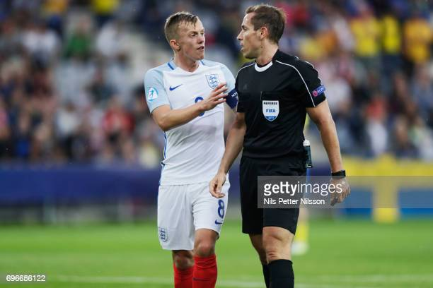 James WardProwse of England and Tobias Stieler referee in discussion during the UEFA European Under21 Championship match between Sweden and England...