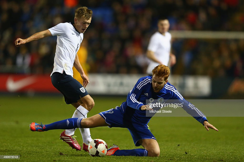 James Ward-Prowse (L) of England fouls Marco Bernardi (R) of San Marino during the 2015 UEFA European U21 Championship Qualifying match between England U21 and San Marino U21 at Greenhous Meadow on November 19, 2013 in Shrewsbury, England.