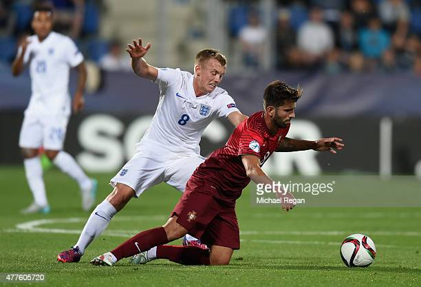 James WardProwse of England in action with Sergio Oliveira of Portugal during the UEFA Under21 European Championship 2015 Group B match between...