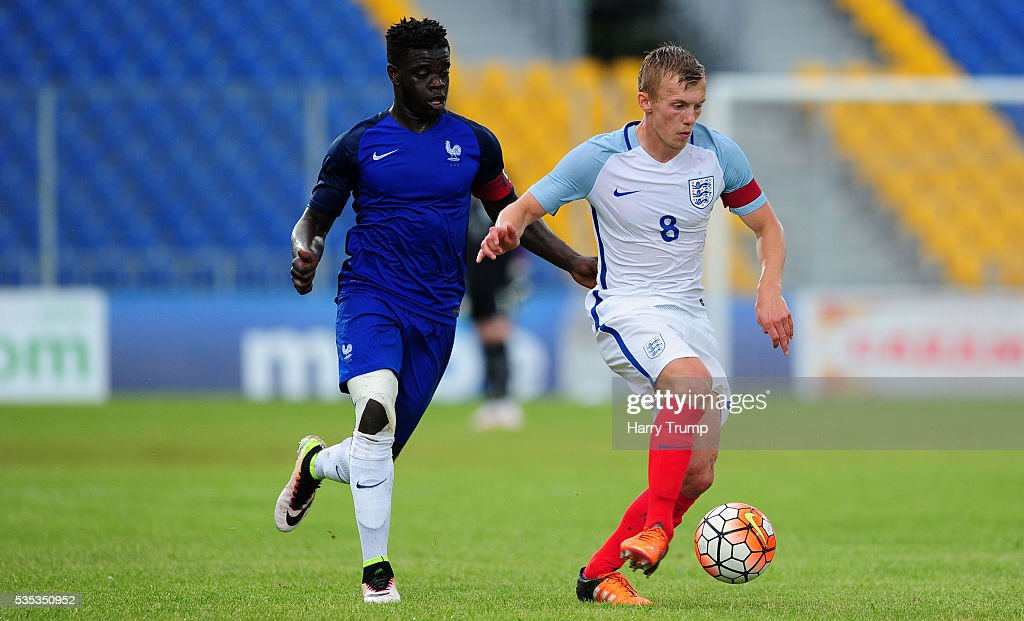 James Ward-Prowse of England is tackled by Olivier Keman of France during the Final of the Toulon Tournament between England and France at Parc Des Sports on May 29, 2016 in Avignon, France.