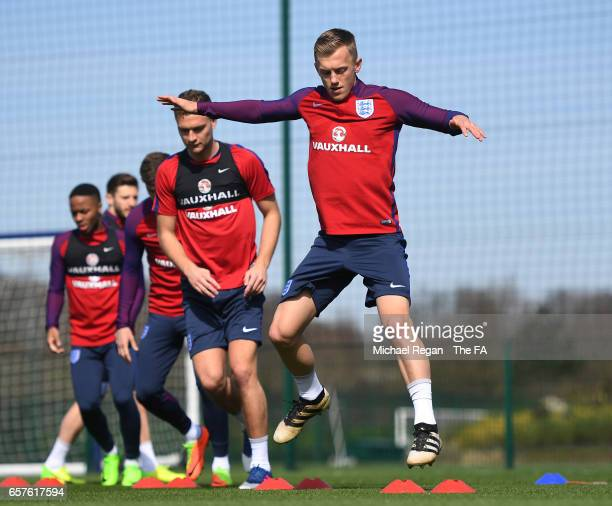 James WardProwse of England runs through drills with teammates during the England training session at the Tottenham Hotspur Training Centre on March...