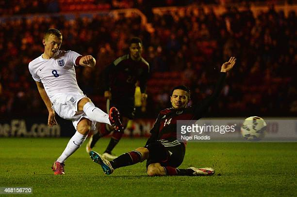 James WardProwse of England scores their third goal under pressure from Julian Korb of Germany during the international friendly between England...