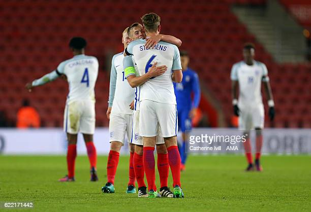 James WardProwse of England U21 hugs Jack Stephens of England U21 during the U21 International Friendly match between England and Italy at St Mary's...