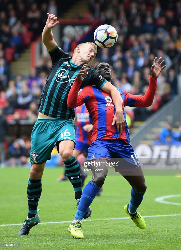 James Ward-Prowse of Southampton and Jeffrey Schlupp of Crystal Palace battle for possession during the Premier League match between Crystal Palace and Southampton at Selhurst Park on September 16, 2017 in London, England.