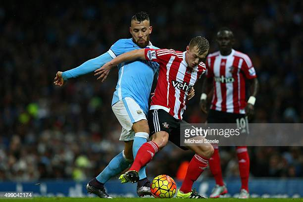 James WardProwse of Southampton and Nicolas Otamendi of Manchester City compete for the ball during the Barclays Premier League match between...