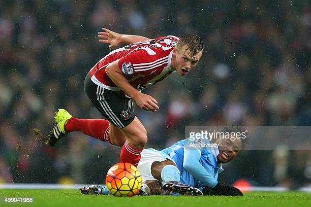 James WardProwse of Southampton and Raheem Sterling of Manchester City compete for the ball during the Barclays Premier League match between...