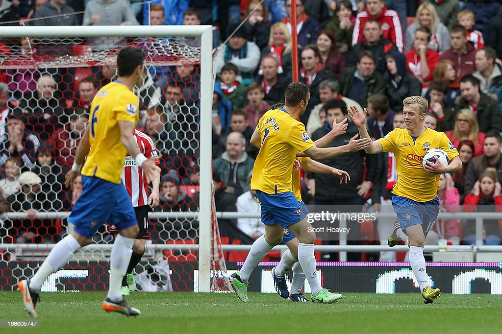 James Ward-Prowse of Southampton (R) celebrates after team-mate Jason Puncheon scored a goal during the Barclays Premier League match between Sunderland and Southampton at the Stadium of Light on May 12, 2013 in Sunderland, England.