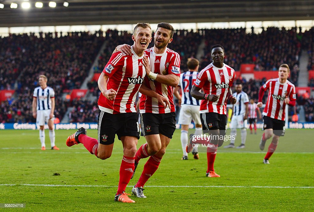 James Ward-Prowse (L) of Southampton celebrates scoring his team's second goal with his team mate Shane Long during the Barclays Premier League match between Southampton and West Bromwich Albion at St. Mary's Stadium on January 16, 2016 in Southampton, England.