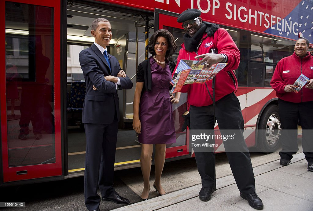 James Washington shows directions to wax figures of President Barack Obama and First Lady Michelle Obama outside of Madame Tussauds wax museum after the pair arrived from a ride through downtown in an open top bus.