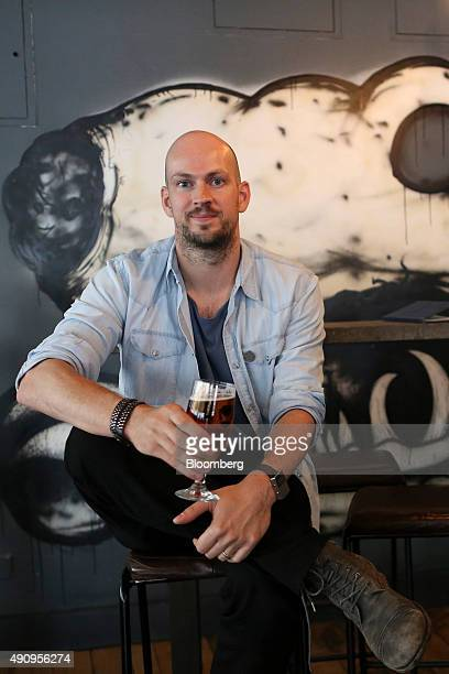 James Watt chief executive officer of Brewdog Plc poses for a photograph at the company's bar in Shoreditch London UK on Tuesday Sept 1 2015 The...