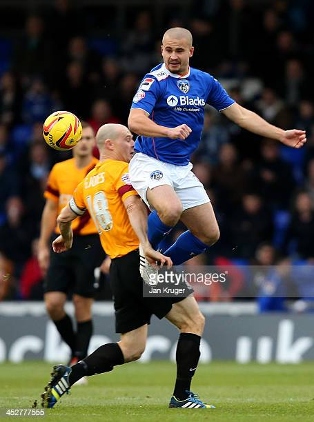James Wesolowski of Oldham Athletic competes for the ball with Gary Jones of Bradford City during the Sky Bet League One match between Oldham...
