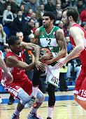 James White #4 of Cedevita Zagreb competes with James Feldeine #12 of Panathinaikos Athens during the Turkish Airlines Euroleague Basketball Top 16...