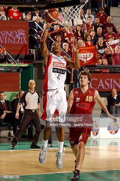 James White of Scavolini competes with Daniele Magro of Umana during the Lega Basket Serie A match between Umana Venezia and Scavolini Siviglia...