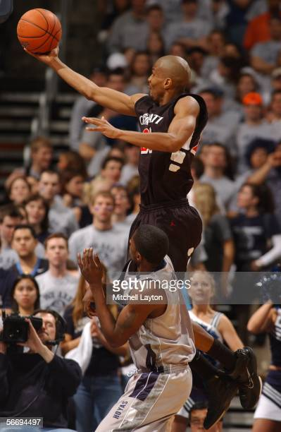James White of the Cincinnati Bearcats drives to the basket against Brandon Bowman of the Georgetown Hoyas on January 28 2006 at MCI Center in...