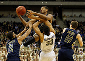 James White of the Georgia Tech Yellow Jackets battles for a rebound against Alonzo NelsonOdoda of the Pittsburgh Panthers during the game at...