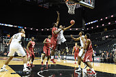 James White of the Georgia Tech Yellow Jackets drives to the basket during game one of the NIT Season TipOff college basketball tournament at...