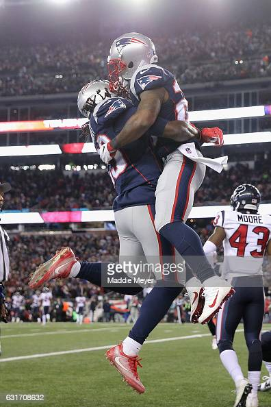 James White of the New England Patriots and LeGarrette Blount#29 celebrate after a touchdown in the third quarter against the Houston Texans during...