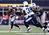 James White of the New England Patriots carries the ball during the first half against the Tennessee Titans at Gillette Stadium on December 20 2015...