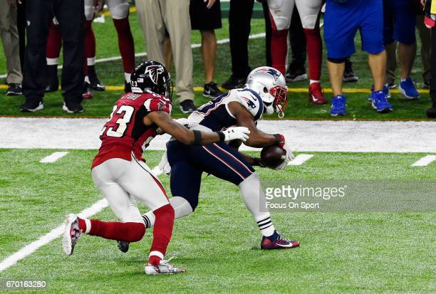 James White of the New England Patriots catches a pass in front of Robert Alford of the Atlanta Falcons during Super Bowl 51 at NRG Stadium on...