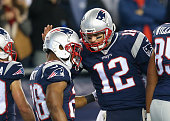 James White of the New England Patriots celebrates in the end zone with Tom Brady of the New England Patriots after scoring a touchdown during the...