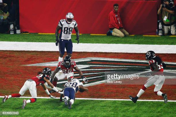 James White of the New England Patriots dives for the end zone against the Atlanta Falcons during the third quarter during Super Bowl 51 at NRG...