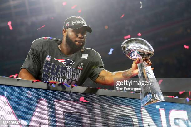 James White of the New England Patriots holds the Vince Lombardi Trophy to celebrate after defeating the Atlanta Falcons 3428 in overtime during...