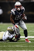James White of the New England Patriots is brought down by Henry Coley of the New Orleans Saints during the third quarter of a preseason game at the...